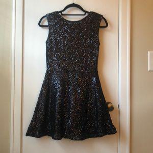 Black sequin mini dress.